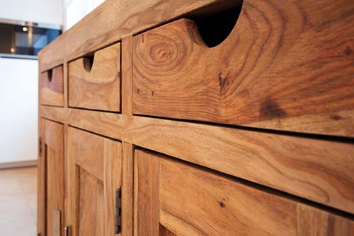 Image showing a wooden dresser or chest of drawers