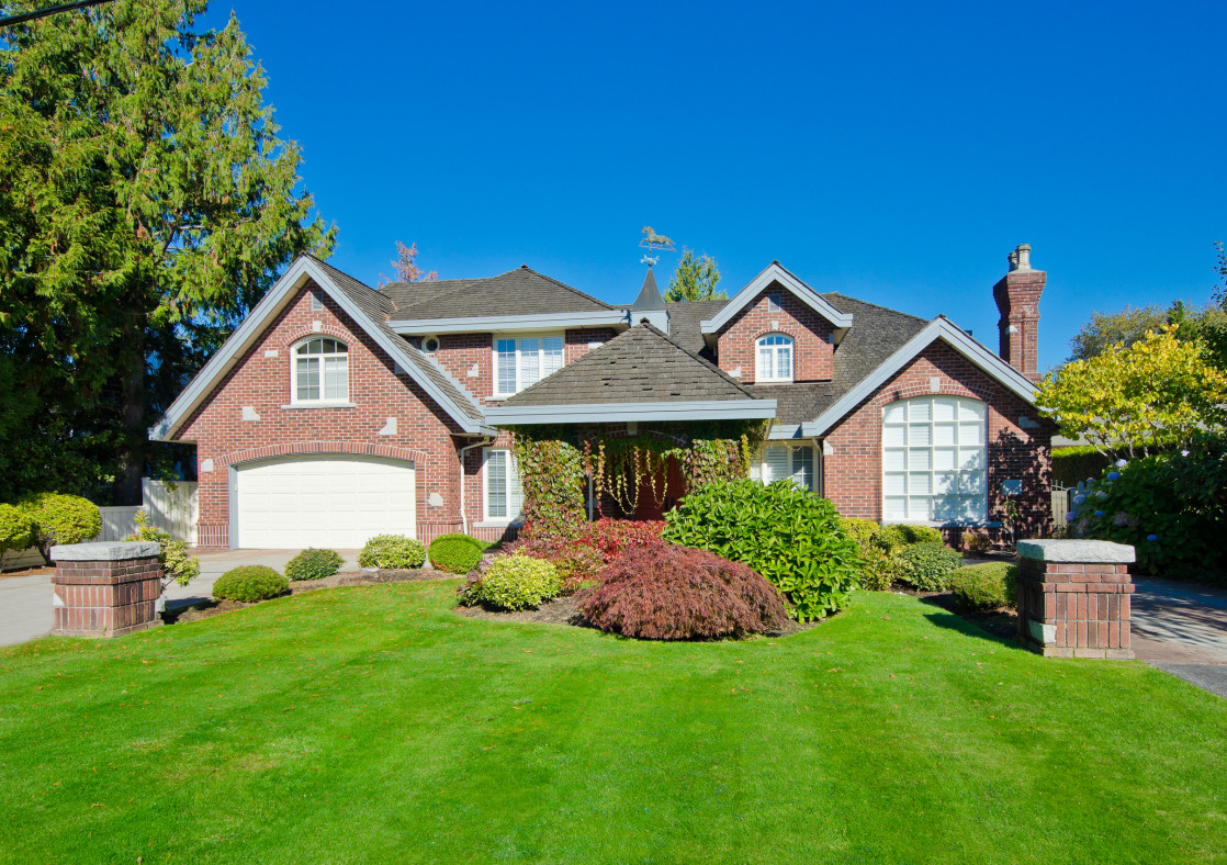 Image of a beautiful home and nicely manicured lawn